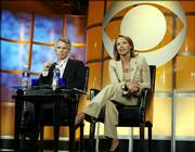 """Katie Couric, anchor for the """"CBS Evening News with Katie Couric,"""" and Sean McManus, president of CBS News and Sports, answer questions about Couric's new role as the first female news anchor for a network evening news broadcast in this July 16 file photo. CBS has significantly changed the content of the evening news behind Couric."""