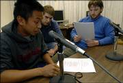 "During a character voice recording session for ""Zook Mayhem and the Bandits"" at Wescoe Hall, Kansas University senior Nolan Jones, Pittsburg, center, listens as sophomore Jose Artiaga, St. Louis, left, and senior Chris Moodi, Pittsburg, practice their lines"