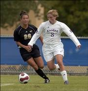 Kansas University senior Holly Gault dribbles around UCF's Sarah de Leon. Gault had a goal and an assist in KU's 2-0 victory Sunday at the Jayhawk Soccer Complex.