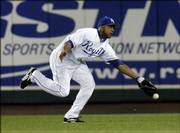 Royals right fielder Emil Brown reaches out but can't get a glove on a ball hit by Los Angeles' Howie Kendrick. The Angels defeated the Royals, 5-2, on Tuesday night in Kansas City, Mo.