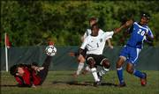 Free State senior Kyle Ceesay (1) nearly puts a shot past Leavenworth goalkeeper Michael Minchew as defender Frankie Washington, right, pursues. Ceesay notched two assists - both to Alex Clayton - in Free State's 2-1 victory Tuesday at Free State.