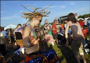 Jenny Aberle, Fargo, N.D., lets her dreadlocks fly as she and thousands of Wakarusa Music Festival partiers dance to Spearhead in this June 2006 file photo. The organizer of the festival says he was not aware that law enforcement surveillance cameras would be set up at the Wakarusa site.