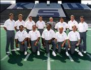 Former Kansas State coach Bill Snyder turned around a dismal Wildcat football program in the 1990s with the help of solid up-and-coming assistants now making a name for themselves in the college game. This photo, taken sometime in the early 1990s, shows (front row, from left): John Latina, Nick Quartaro, Kevin Ramsey, Del Miller, Bruce Van De Velde. (back row, from left): Dana Dimel, Jim Leavitt, Jerry Palmieri, Bob Stoops, Bill Snyder, Mark Mangino, Mike Stoops and Bob Cope.