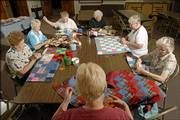 A group of quilters at Central United Methodist Church gathers each week to make quilts to give to palliative care patients at Lawrence Memorial Hospital. Clockwise from bottom are Sally Johnson, Frances Mercer, Erma Worley, Lorene Davison, Geneva Pohl, Vera Hadl and Hazel Burgert.