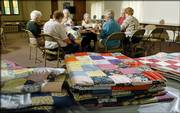 A group of quilters at Central United Methodist Church gathers each week to make quilts to give to palliative care patients at Lawrence Memorial Hospital.