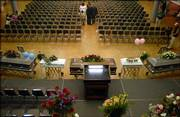 Funeral services were held Sunday at the Kansas Union Ballroom for the Glover familiy members who were recently killed in a overnight fire. Five coffins lay in state in the ballroom as over 1,000 friends and family members attended the funeral.