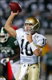 Notre Dame quarterback Brady Quinn throws a pass against Michigan State. Quinn helped the 12th-ranked Fighting Irish rally for a wild 40-37 victory Saturday in East Lansing, Mich.
