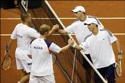 Russia's Mikhail Yuzhny, left, and Dmitry Tursunov, second from left, shake hands with the United States' Bob  Bryan and Mike Bryan, right, after the semifinal match of the Davis Cup. The Bryans won the match, but Russia sent the U.S. tumbling out of the Davis Cup, 3-2.