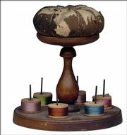 The Shakers, a religious sect that settled in the United States, believed in simplicity. This turned-wood spool holder with a pincushion is 6 inches high.