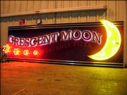 Star Signs & Graphics, Lawrence, produced signage for the Superdome's concession stands, such as Crescent Moon.