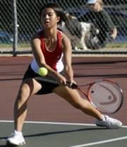 Lawrence High's Lucy Liu returns a shot in her doubles match against Free State. Liu and Lily Boyce fell to Leigh Luina and Julia Guard on Monday at the Lawrence Tennis Center. Story on page 1C.