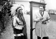 "William ""Lone Star"" Dietz, head football coach of the Haskell Indians, right, starts work on one of his paintings. Louis ""Rabbit"" Weller, halfback and captain of the Haskell team, left, posed in costume for the painting on Nov. 16, 1931, at the Haskell Institute. Below, Dietz is believed to have drawn this depiction of a Carlisle Indian Industrial School football player in 1910."