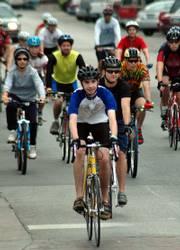 Riders participating in the 36th annual Octoginta ride down Massachusetts Street last year for the Tour de County. This year's Octoginta events, sponsored by the Lawrence Bicycle Club, begin Saturday.