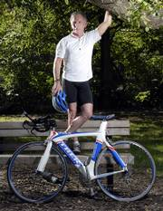 Lawrence optometrist Kent Dobbins recently won the United States Amateur Triathlon half-ironman national championship for the 60-64 age group. Dobbins, 61, participates in four to six triathlons a year.