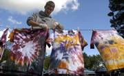 "Sigma Alpha Epsilon fraternity member Luke McKee hangs T-shirts on a line behind the fraternity house Thursday morning. The house is having a party called ""Mello Jello"" in preparation for homecoming next week."