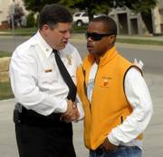 Mark Bradford, chief of Lawrence-Douglas County Fire & Medical, greets Charles Glover Jr. before a news conference where Bradford reported that investigators could not determine the cause of an East Lawrence house fire that killed five people earlier this month. The fire killed Glover's father, Charles Glover Sr., 66, and four grandchildren living with him.