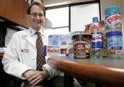 Dr. Russell Rothman, of Vanderbilt University Medical Center in Nashville, Tenn., displays some of the products he used in his study of nutrition labels and how well people understand them. According to Rothman's findings, people often don't factor in serving size or miscalculate how much they're eating.