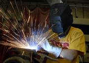 Mark Higgins, 15, a sophomore at Perry-Lecompton High School, throws some sparks as he practices welding last week at school. Many high school graduates will opt for vocational training over a traditional four-year college education, and the state has become highly dependent on this corps of technical professionals.