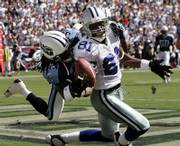 Dallas cowboys wide receiver Terrell Owens (81) can't hold on to a pass in the end zone as Tennessee cornerback Pacman Jones defends. The Cowboys rolled, 45-14, Sunday in Nashville, Tenn.