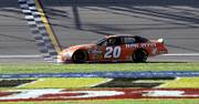 Tony Stewart coasts across the finish line at Kansas Speedway. Stewart won the Banquet 400 on Sunday in Kansas City, Kan.