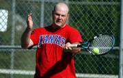 John Ritchey, Baldwin, competes against Dick Wedel, of Lawrence, during the Douglas County Closed Tennis Tournament at Lawrence High School Sunday.