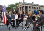"Massachusetts Gov. Mitt Romney, left, presents a proclamation marking ""Fox News Channel Day"" to Steve Doocy, second from left, E.D. Hill, center right, and Brian Kilmeade, right, the cast of ""Fox and Friends"" during a broadcast last month at Quincy Market in Boston. The Fox News Channel was in Boston to kick off a 10-city tour for its 10th anniversary, which is Saturday."
