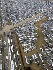Some of the nearly 10,000 FEMA mobile homes sit at the Hope, Ark., airport in this Feb. 24, 2006, file photo. A provision of the homeland security spending bill approved by Congress last week allows FEMA to sell or donate the trailers to municipalities, nonprofit groups or American Indian tribes.