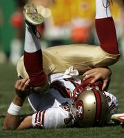 San Francisco quarterback Alex Smith is upended. The Chiefs sacked Smith five times in Sunday's 41-0 victory.
