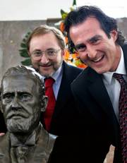 Andrew Z. Fire, left, of the School of Medicine at Stanford University in California, and Craig C. Mello, from the Howard Hughes Medical Institute at the Massachusetts Medical School in Worcester, Mass., pose next to a statue of German scientist Paul Ehrlich after being awarded the Paul Ehrlich and Ludwig Darmstaedter award in Frankfurt, Germany, in this March 14, 2006, file photo. Mello and Fire were named winners of the Nobel Prize in medicine on Monday for discovering a way to turn off the effect of specific genes.