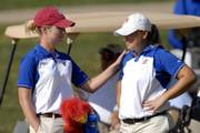 KU women's golf coach Erin O'Neil, left, talks with KU golfer Amanda Costner. Costner's individual lead slipped away in the last round of the Marilynn Smith Sunflower Invitational on Tuesday at Alvamar, but the Jayhawks took home the team title.