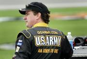 "Joe Nemechek, wearing a U.S. Army logo, waits to qualify for the NASCAR Banquet 400 on Friday at Kansas Speedway in Kansas City, Kan. The Army is about to update its ""Army of One"" slogan, with the help of Fort Riley soldiers. A spokesman says the new slogan will be an evolution of the ""Be All You Can Be"" campaign the Army launched in 1981."
