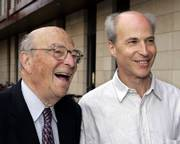 Nobel laureate Arthur Kornberg, left, smiles with his son Roger D. Kornberg, of Stanford University, who won the Nobel Prize in chemistry Wednesday. He was awarded the prize for his studies of how cells take information from genes to produce proteins, a process that could provide insight into defeating cancer and advancing stem cell research. Arthur Kornberg shared the 1959 Nobel medicine prize with Severo Ochoa, for their studies of how genetic information is transferred from one DNA molecule to another.