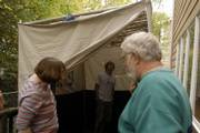 Jack Berkowitz, center, checks out the inside of his family's sukkah, a hut used to celebrate the Jewish holiday Sukkot, a joyous time that starts tonight and lasts seven days. Berkowitz and his parents, Katherine, left, and Dave, will share some meals and time with friends inside the structure.