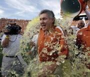 Texas coach Mack Brown takes a Gatorade shower after beating Oklahoma in the Red River rivalry. The Longhorns made it two straight victories over the Sooners with Saturday's 28-10 triumph at the Cotton Bowl in Dallas.
