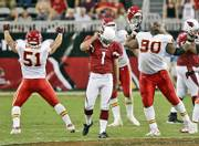 Kansas City's Boomer Grigsby (51) and Ryan Sims (90) celebrate after Arizona kicker Neil Rackers (1) missed a potential game-tying field goal in the final seconds. The Chiefs won, 23-20, Sunday in Glendale, Ariz.