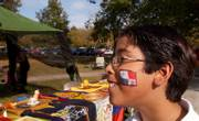 Jason Castillo, 10, displays the Panama flag face painting he received at the celebration of Latin American culture in South Park. Sunday afternoon's celebration featured authentic food, music, clothing, artifacts and dancing.