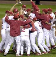 The Cardinals celebrate after beating the San Diego Padres in Game 4 of the National League Division Series. St. Louis won, 6-2, on Sunday in St. Louis.