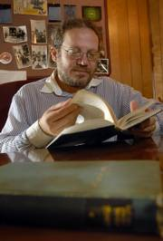 "Jonathan Boyarin, Kansas University professor of religious studies, reads from a book in Yiddish by author Abraham Joshua Heschel, ""Kotzk:The Struggle for Integrity."" Boyarin has done research on Yiddish, and he believes there is a resurgence in the language and that it continues to have an impact on English."