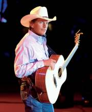 "Country singer George Strait&squot;s latest album, ""It Just Comes Natural,"" is classic Strait, a blend of honky-tonk, Western swing and barroom ballads."