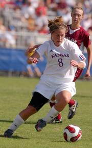 Kansas senior Holly Gault struggles to keep the ball away from Texas A&M during the Jayhawk's home game Sunday. Kansas lost to Texas 1-0 in over time.