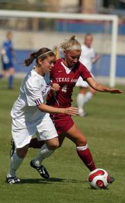 KU's Jessica Kilpatrick tries to keep the ball away from Texas A&M's Amber Gnatzig.