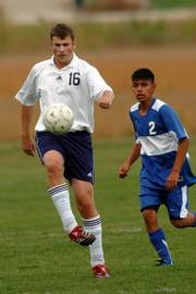 Seabury Academy's Simon Thompson (16) controls the ball as Kansas City Sumner's Alfredo Ceron comes up to challenge the play. Thompson had an assist Monday in the Seahawks' 2-0 victory at the Youth Sports Inc., fields.