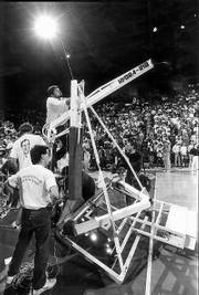 Workers had to replace the backboard after Alonzo Jamison's violent dunk during the 1988 Late Night.