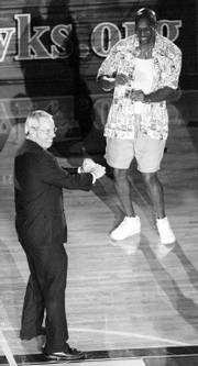 Former KU coach Roy Williams, left, showed Kenny Gregory how to dance during 1998&#39;s Late Night.