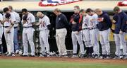 Detroit players observe a moment of the silence in memory of the Yankees' Cory Lidle before the start of Game 2 of the ALCS. Lidle's death in a plane crash Wednesday rattled players and officials throughout baseball.