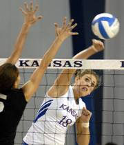 Kansas' Savannah Noyes, right, spikes in KU's victory over Kansas State. The Jayhawks snapped a five-match losing streak with a 3-1 victory over the Wildcats on Wednesday at Horejsi Center.