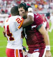 Kansas City's Ty Law, left, hugs Arizona quarterback Matt Leinart. Leinart made his first NFL start Sunday in Glendale, Ariz.