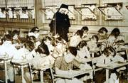 This 1956 photograph shows a classroom at St. John Catholic School. St. John and Corpus Christi Catholic Churches now have separate parochial schools.