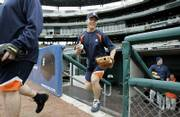 Detroit third baseman Brandon Inge, center, and pitcher Todd Jones, right, take the field for workouts on Thursday at Comerica Park in Detroit.