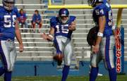 Kansas punter Kyle Tucker (15) punts during warmups before facing Oklahoma State last season.